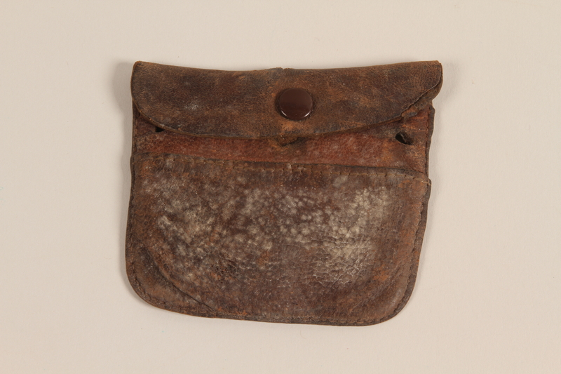 1989.297.2.2_001.JPG Brown leather pouch owned by a Danish resistance member
