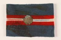 1989.297.4 front Blue armband with a royal coat of arms medallion issued to a Danish resistance fighter  Click to enlarge
