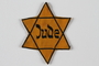 Star of David badge with word Jude issued to an inmate of Lodz ghetto
