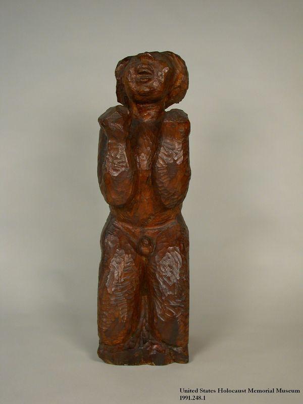 1991.248.1 front Bent knees praying figure carving