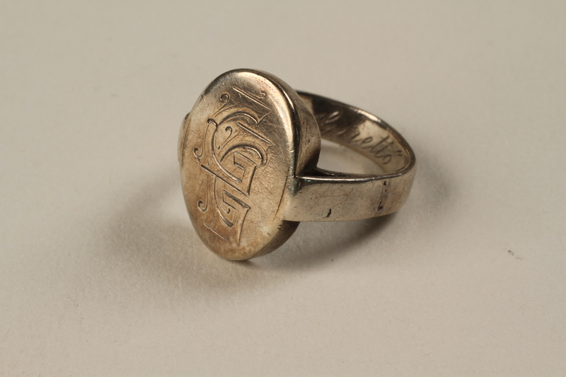 2003.407.1 front Friendship ring engraved GG made from silver spoons in the Riga ghetto