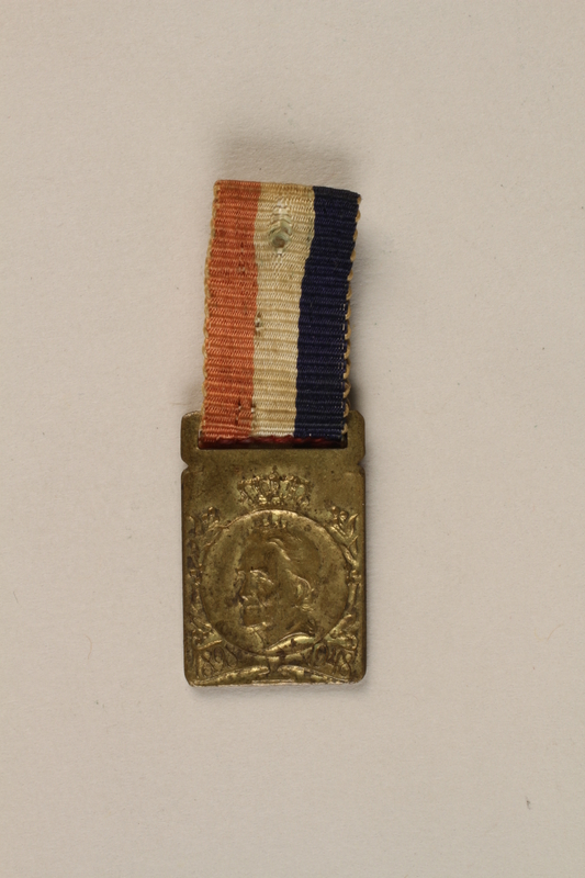 2003.419.2 front Queen Wilhemina of the Netherlands 1898-1948 miniature medal owned by a former hidden child