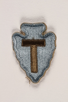 2000.561.3 front US Army 36th Infantry Division shoulder sleeve patch with a T monogram on a light blue field  Click to enlarge
