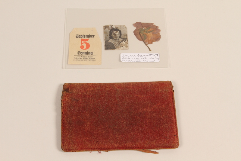2004.40.2 front Dark red leather wallet used by a Polish Army officer to hold military ID