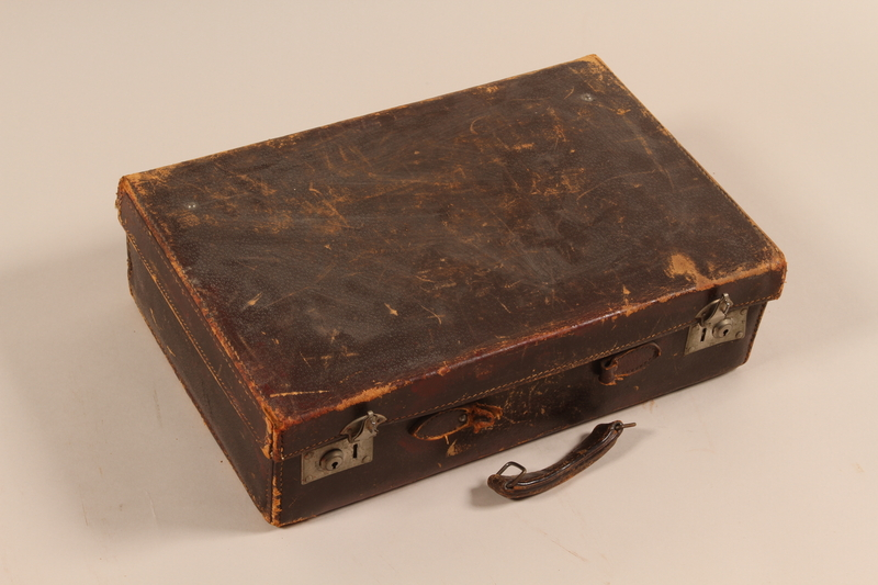 2003.442.2 front Small leather suitcase used by a Hungarian Jewish family while living in hiding
