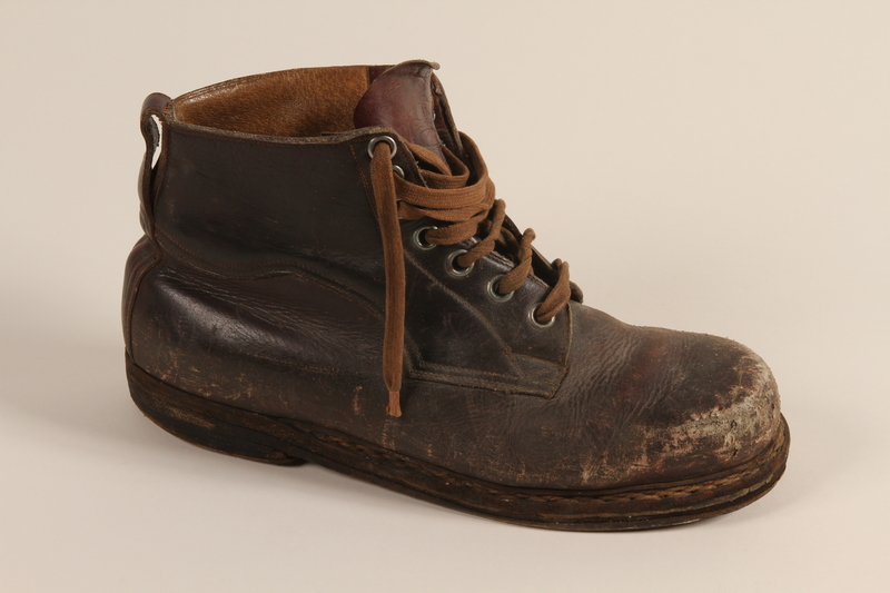 2003.442.3 a front Brown leather work boots worn by a Hungarian Jewish man for forced labor and in hiding