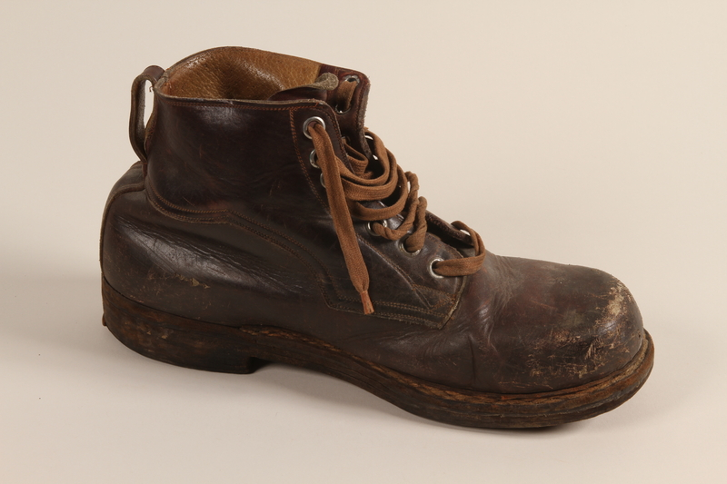 2003.442.3 b front Brown leather work boots worn by a Hungarian Jewish man for forced labor and in hiding