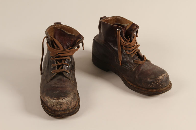 2003.442.3 a-b front Brown leather work boots worn by a Hungarian Jewish man for forced labor and in hiding