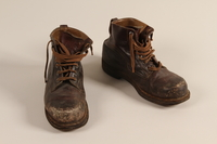 2003.442.3 a-b front Brown leather work boots worn by a Hungarian Jewish man for forced labor and in hiding  Click to enlarge