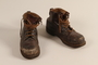 Brown leather work boots worn by a Hungarian Jewish man for forced labor and in hiding