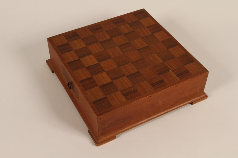 1988.72.1 front Handmade wooden checkers set presented to Director, ORT schools, DP camps