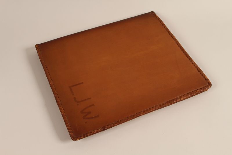 1988.72.22 front Monogrammed leather binder made for Director, ORT vocational schools, DP camps