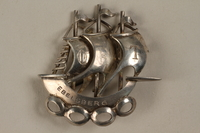 1988.72.23 front Silver brooch of a 3 masted ship given to Director, ORT schools, DP camps  Click to enlarge