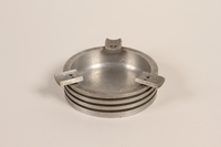 1988.112.59 front Piston head ashtray made for concentration camp commander found by US military aid worker  Click to enlarge