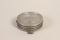 1988.112.59 back Piston head ashtray made for concentration camp commander found by US military aid worker  Click to enlarge