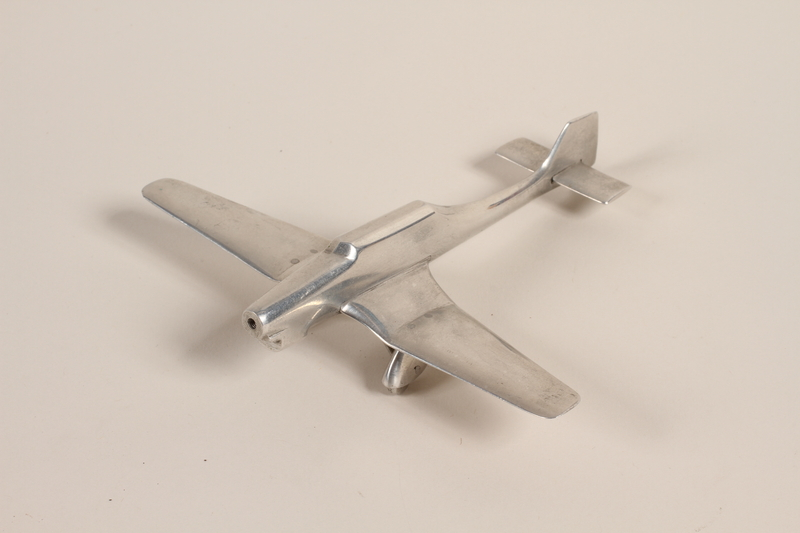 1988.112.61 front Model Stuka airplane made by liberated concentration camp inmate and given to US military aid worker