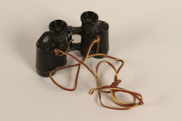 1988.112.62 front Zeiss Z body binoculars found in a concentration camp by US military aid worker  Click to enlarge