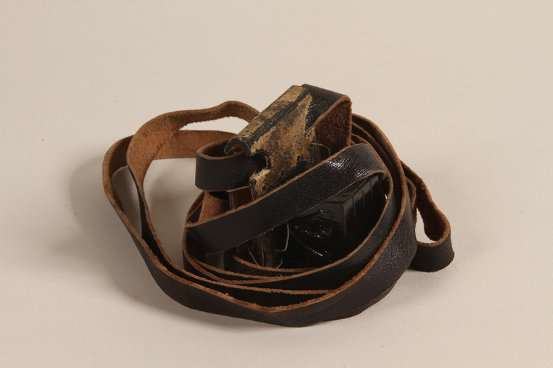 2000.580.1 a front Pair of tefillin taken from a concentration camp by an inmate at liberation