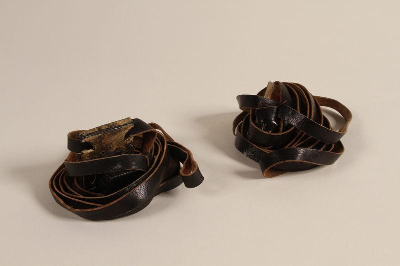 2000.580.1 a-b front Pair of tefillin taken from a concentration camp by an inmate at liberation