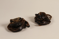 2000.580.1 a-b front Pair of tefillin taken from a concentration camp by an inmate at liberation  Click to enlarge