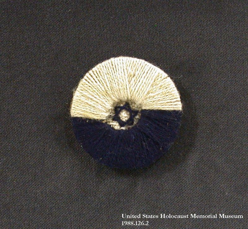 1988.126.27 front Pin embroidered with a Star of David given to an inmate at Berger Belsen for her birthday