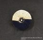 Pin embroidered with a Star of David given to an inmate at Berger Belsen for her birthday