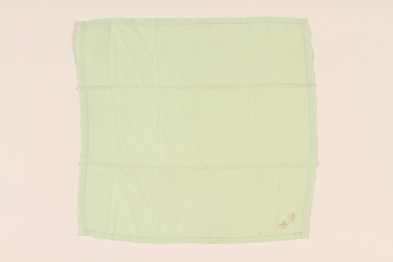 2003.454.2 front Green handkerchief with pink KS monogram carried by a Kindertransport refugee