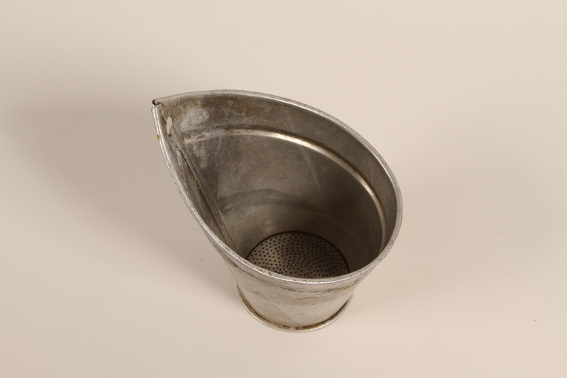 2000.588.3 front Metal milk strainer used by a farm family