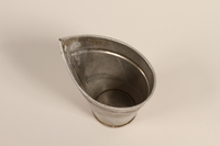 2000.588.3 front Metal milk strainer used by a farm family  Click to enlarge