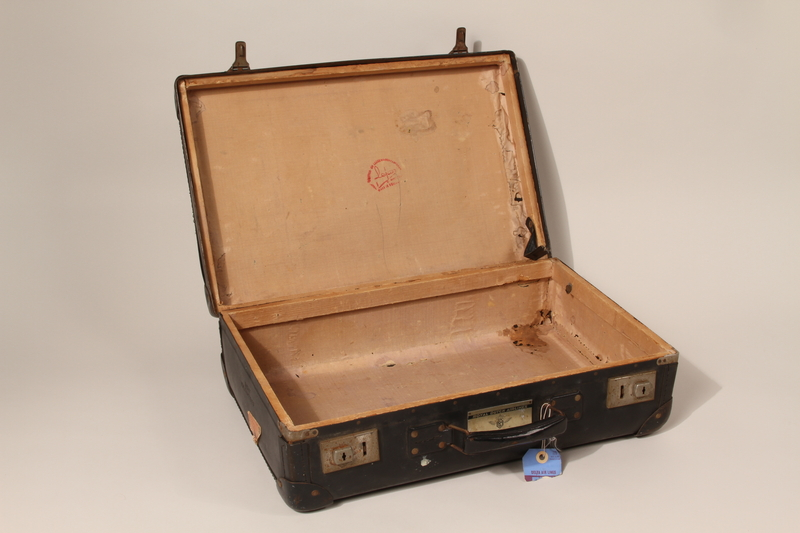 2004.301.2 open Black Vulcanfiber suitcase used by a Dutch Jewish family while in hiding