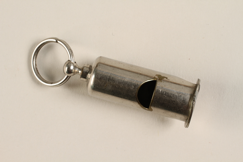 2000.598.1 front Silver pea whistle taken from an SS officer by a US soldier