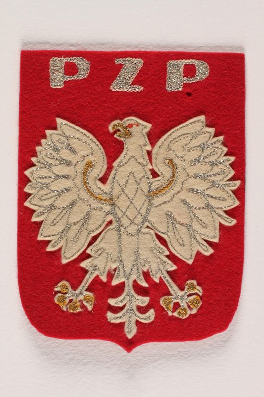2004.374.2 front Polish Union of Swimming red felt badge with an eagle awarded postwar to a Polish Army swim coach