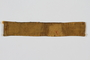 Yellow cloth strip sewn to a slave laborer's uniform to identify her as a Jew
