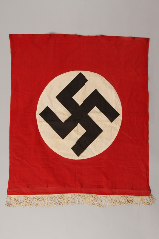 1997.132.2 front Nazi banner with swastika and white fringe
