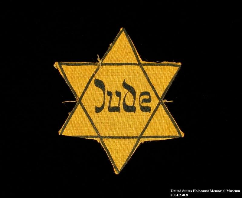 2004.230.8 front Star of David badge printed Jude worn by a German Jewish woman