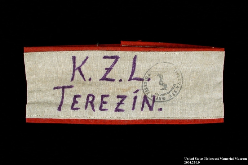 2004.230.9 front Handmade white armband inscribed Terezin worn by a female German Jewish inmate