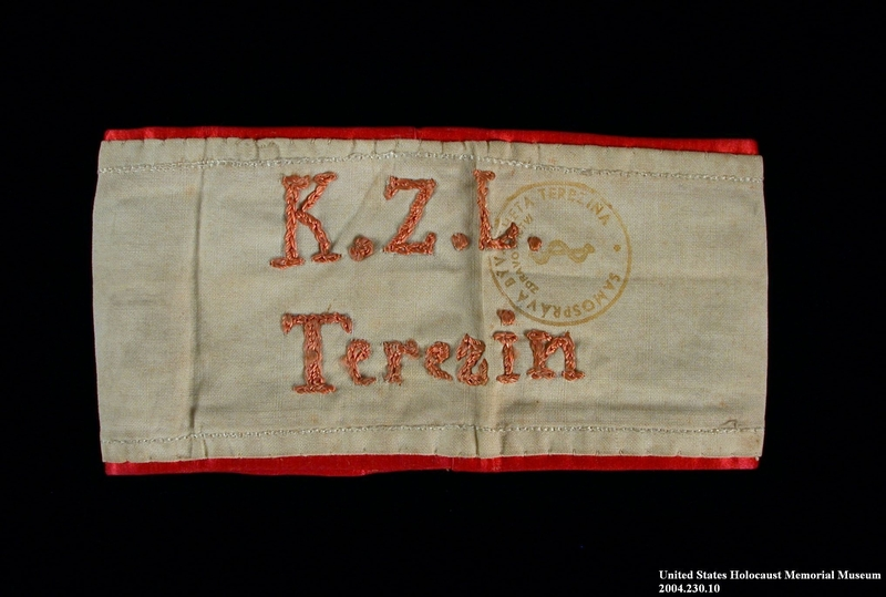 2004.230.10 front Handmade white armband embroidered K.Z.L. Terezin and worn by a female German Jewish inmate