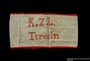 Handmade white armband embroidered K.Z.L. Terezin and worn by a female German Jewish inmate