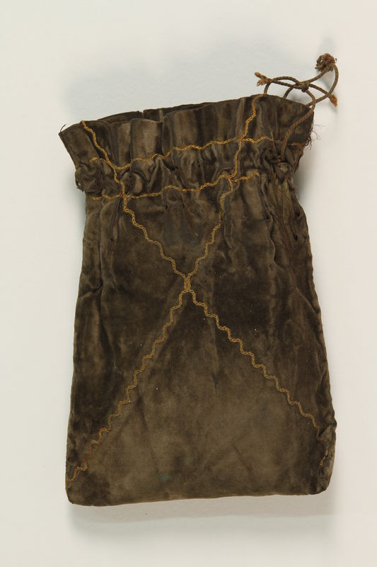 2004.333.2 front Tefillin storage pouch buried for safekeeping and recovered postwar
