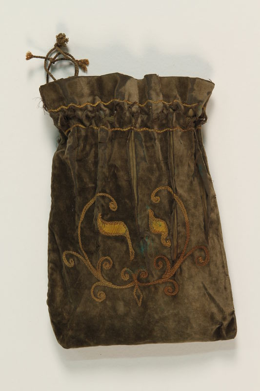 2004.333.2 back Tefillin storage pouch buried for safekeeping and recovered postwar