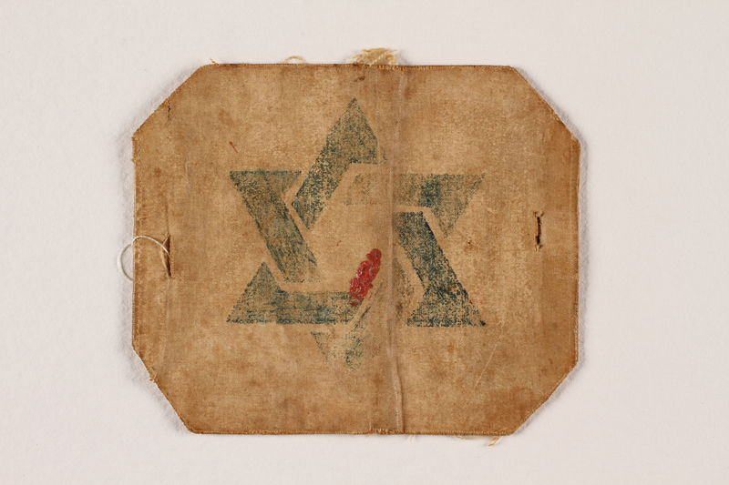 2004.437.3 front Tan armband with a Star of David worn in the Trembowla ghetto