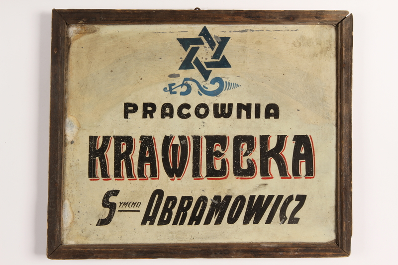 2004.483.1 front Painted metal sign with a blue Star of David from a tailor workshop in the Warsaw ghetto