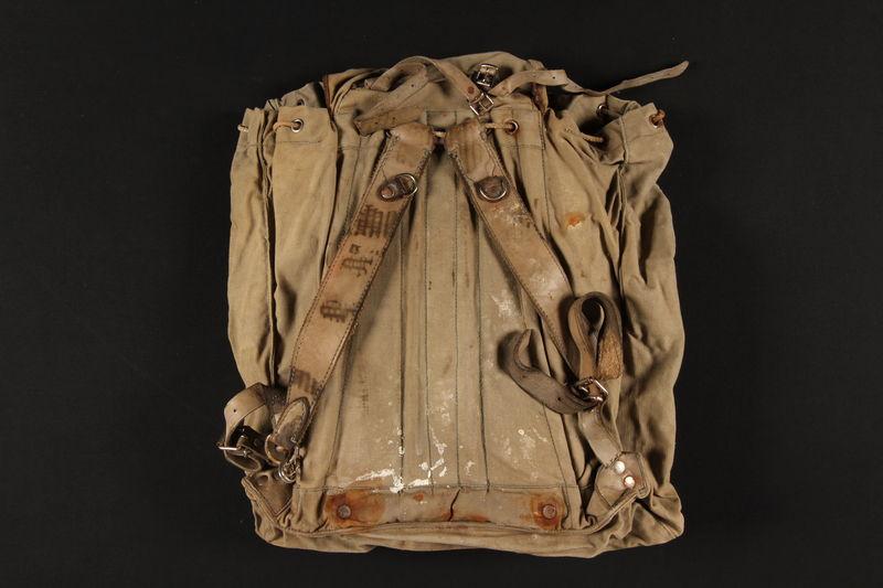 2004.485.6 back Khaki canvas knapsack brought to the US by a German Jewish refugee