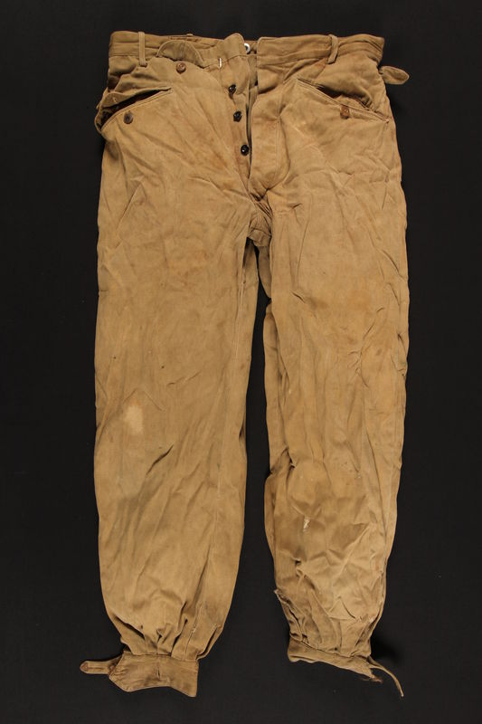2004.485.10 front Brown knee length tapered pants brought to the US by a German Jewish refugee