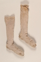 Pair of light brown cotton knee high socks brought to the US by a German Jewish refugee