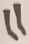 Pair of gray wool knit knee high ribbed socks brought to the US by a German Jewish refugee