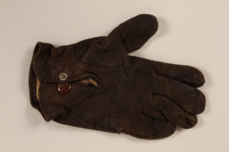 2004.485.28 back Brown Nappa leather left hand glove brought to the US by a German Jewish refugee