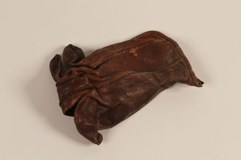 2004.485.30 front Brown leather right hand glove brought to the US by a German Jewish refugee