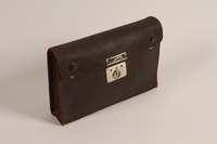 2004.485.34 front Small dark brown leather briefcase used by a German Jewish refugee  Click to enlarge
