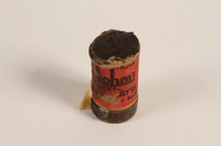 2004.485.45 front Red container of used ski wax brought to the US by a German Jewish refugee  Click to enlarge